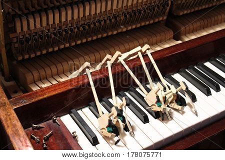 Mending and tuning of the old piano