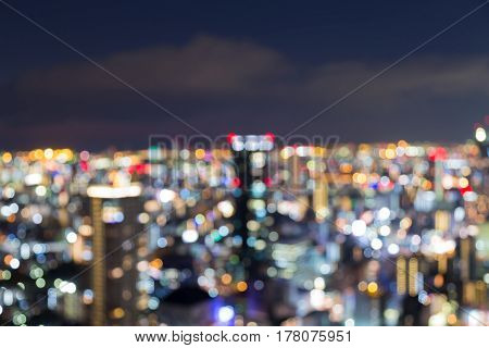 Abstract blurred bokeh light Osaka city central business downtown with twilight sky background