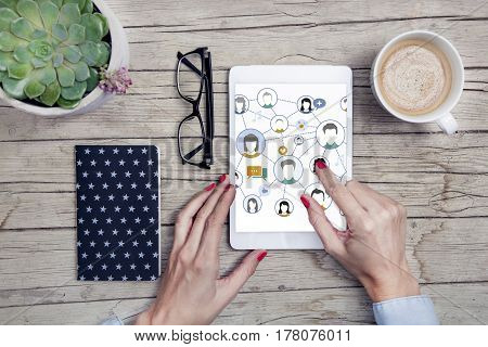 Office Desk With Social Media Tablet, Handy, Notepad And Cup Of Coffee