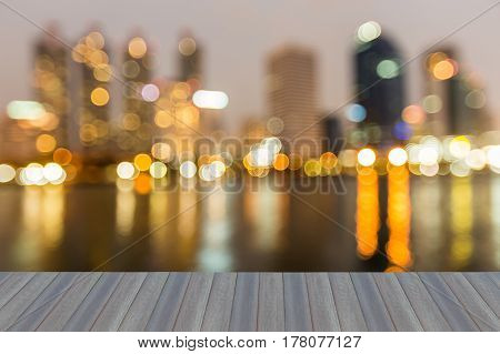 Opening wooden floor reflection blurred light office building with water front abstract background