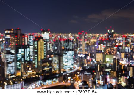 Night blurred bokeh light Osaka city central business downtown abstract background