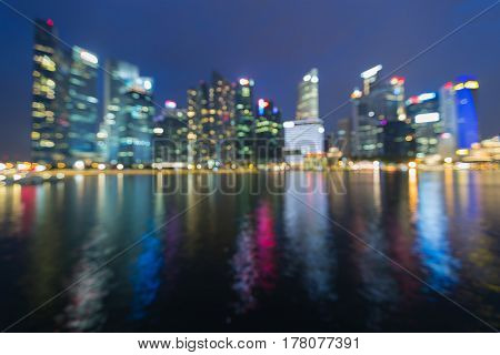 Blurred bokeh light Singapore central business downtown abstract background