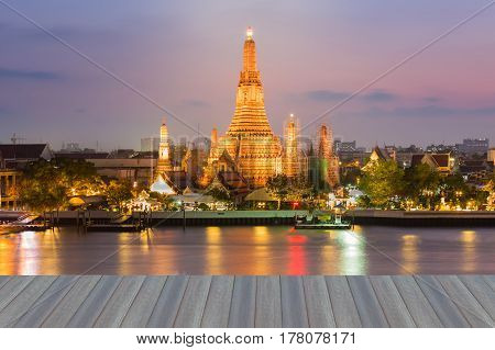 Opening wooden floor Arun temple water front with beautiful after sunset sky background Bangkok Thailand