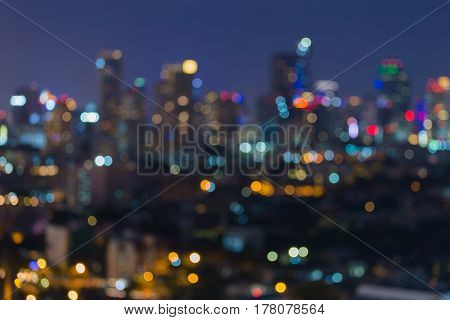 Night blurred bokeh city office building light abstract background