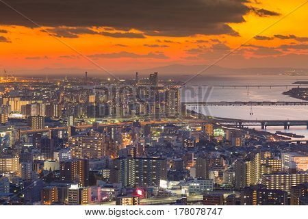 Aerial view Osaka city downtown with beautiful sunset sky background Japan