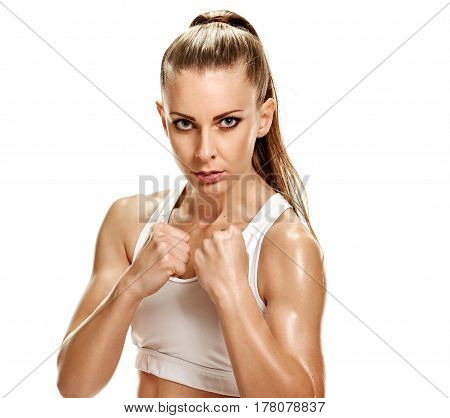 Portrait of young attractive woman showing fists and ready to fight