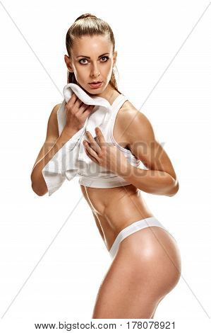 Exhausted athletic woman using towel after hard training