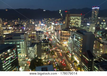 Aerial view city of Kobe business downtown blurred bokeh light abstract background