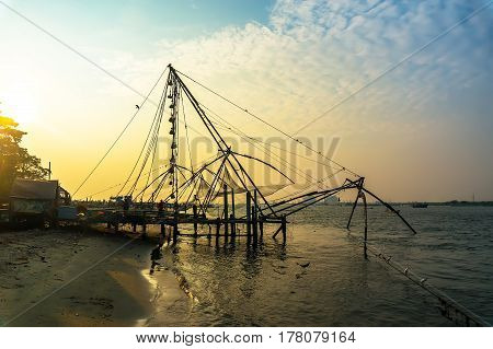 Chinese Fishing Nets On The Shore Of The Arabian Sea. Fort Cochin, Kerala, India. Historic Landmark.