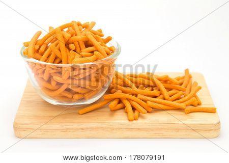 Cracker strick on glass bowl on white background