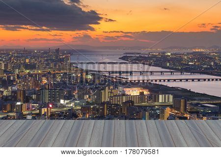 Opening wooden floor Sunset over aerial view Osaka city downtown Japan cityscape background