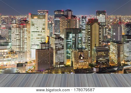 Opening wooden floor Osaka city business downtown night view Japan