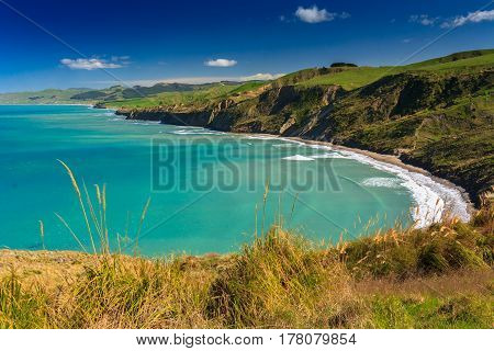 green hills and sea landscape, location - Castlepoint, North Island, New Zealand