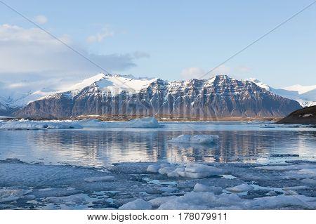 Beautiful Jokulsarlon winter lake with mountain and blue sky background Iceland winter season landscape background