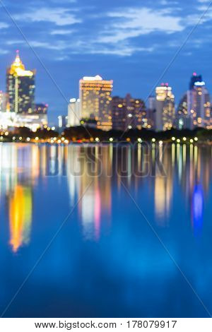 Reflection blurred bokeh city office building light abstract background