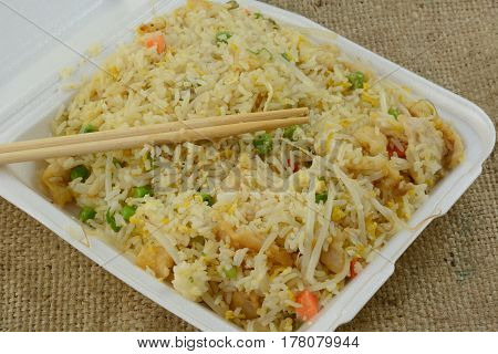 Chinese-American food take out of steamed fried rice with chicken, egg and vegetables