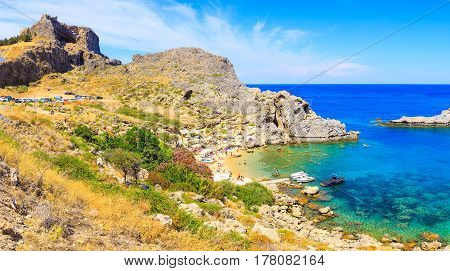 Bay St. Paul and Acropolis of Lindos. Bottom view. Rhodes Greece. A bright Sunny day and the beach.