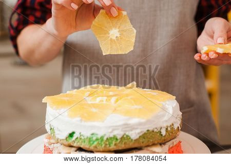 Orange decoration of homemade biscuit cake. Culinary blog. Creative cuisine, good housewife, colorful healthy food concept