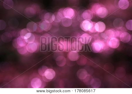 Bokeh light of ilumination night background in pink concept.