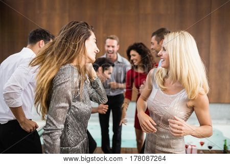 Group of young friends dancing at the party