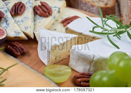 A cheeseboard with blue cheese and fruits