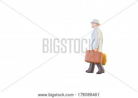 Close Up Of Miniature Businessman And Tourist People Isolated With Clipping Paht On White Background