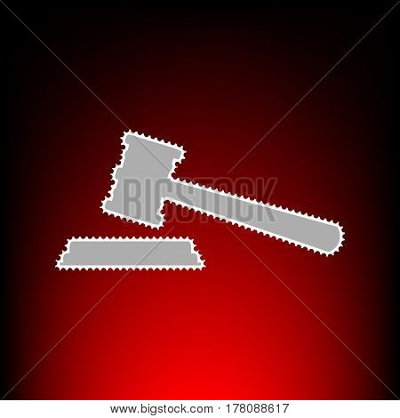 Justice hammer sign. Postage stamp or old photo style on red-black gradient background.