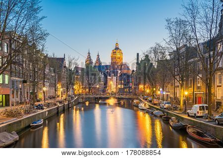Church Of Saint Nicholas In Amsterdam City At Night In Netherlands