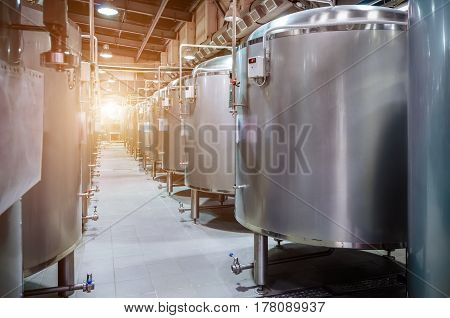 Modern Beer Factory. Small steel tanks for storage and fermentation of beer. Sunlight effect