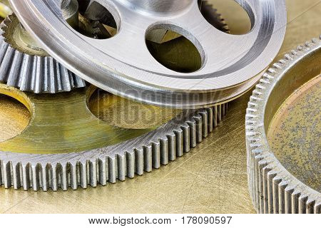 Grey Metal Industrial Gear Cogwheels On Scratched Background Macro