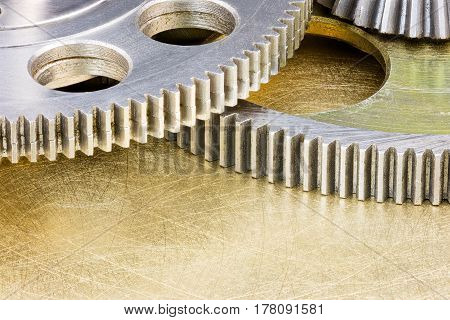 Parts Of Industrial Machines. Metal Gear Cogwheels On Scratched Background.