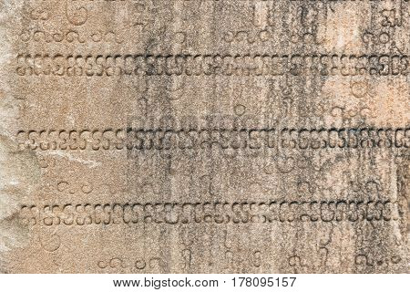 Stone background with inscriptions. Sacred Cham nscriptions and patterns on the wall of main tower of Po Nagar. Nha Trang Vietnam.