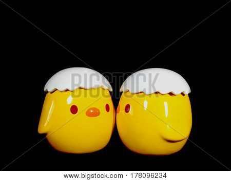 Two Vivid Yellow Kissing Baby Chicks Ceramic Doll on Black Background