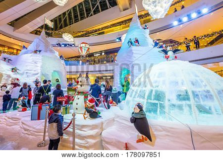 Hong Kong, China - December 2, 2016: The surprise of an amazed child watching the big ice sculptures with festive decorations inside the famous IFC Mall in Central district of Hong Kong island.