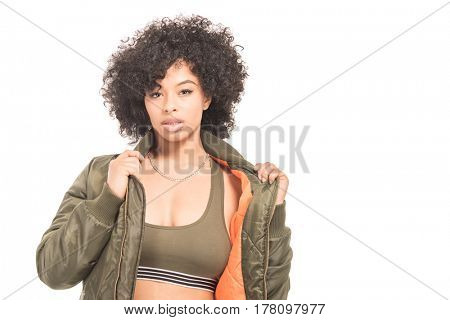 Teenage model with urban fashion clothes isolated on a white background - plenty of copy space