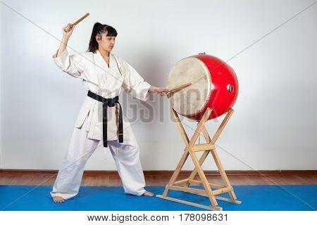 Woman In A Kimono Pounding The Drum