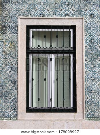 A typical portuguese window with azulejo tiles