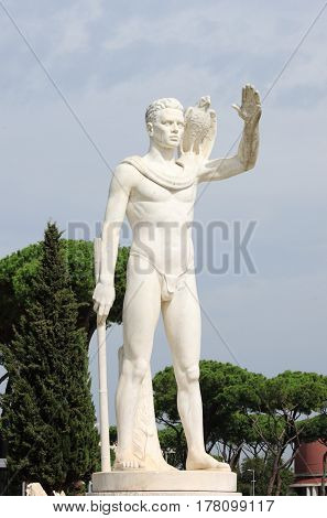 Statue of a falconer in the Foro Italico district of Rome, Italy
