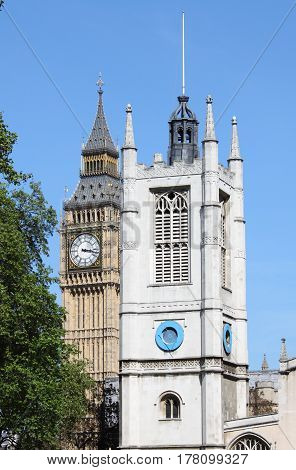 St. Margaret Church tower and Big Ben in London, UK