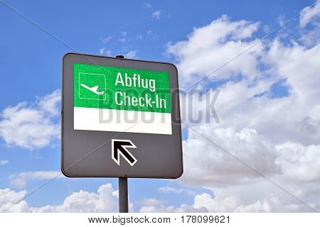 Signpost on the check-in area of an airport, with blank white area for self-labeling