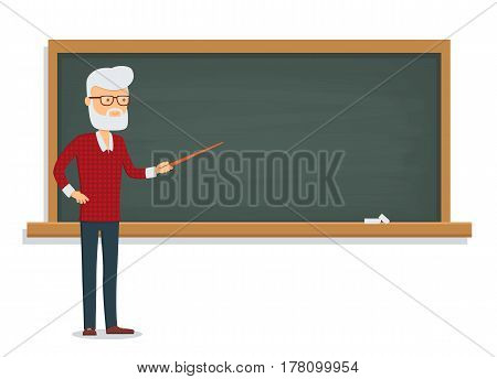 Senior male teacher teaches a lesson on the chalkboard.