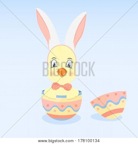 A chicken in a hoop with ears like a rabbit sits in the Easter egg.