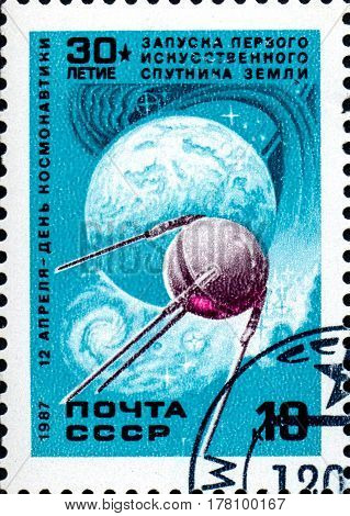 UKRAINE - CIRCA 2017: A stamp printed in the USSR shows the first artificial Earth satellite April 12 - Day of Astronautics circa 1987