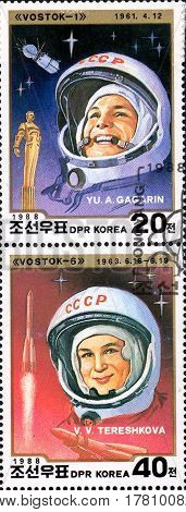 UKRAINE - CIRCA 2017: A set of two postage stamps printed in DPR KOREA shows first cosmonaut Gagarin and first cosmonaut woman Tereshkova circa 1988