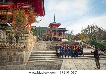 KYOTO, JAPAN - NOVEMBER 9, 2016: People at the Kiyomizu-Dera Buddhist temple in Kyoto, Japan. Kiyomizu-dera built in 1633, is one of the most famous landmarks of Kyoto with UNESCO World Heritage