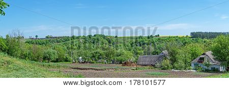 Panoramic view of a typical rural area in the early spring during the processing of agricultural land