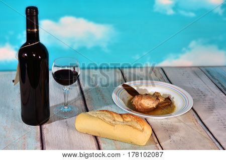 still life with wine bread and chicken stew