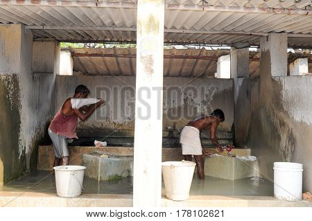 Mans Washing Laundry At Fort Cochin On India