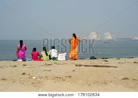 People Watching The Sea On The Beach Of Fort Cochin