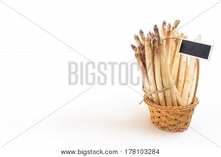 Bunch Of White Asparagus Spears In A Wicker Basket, On White Background And Copy-space